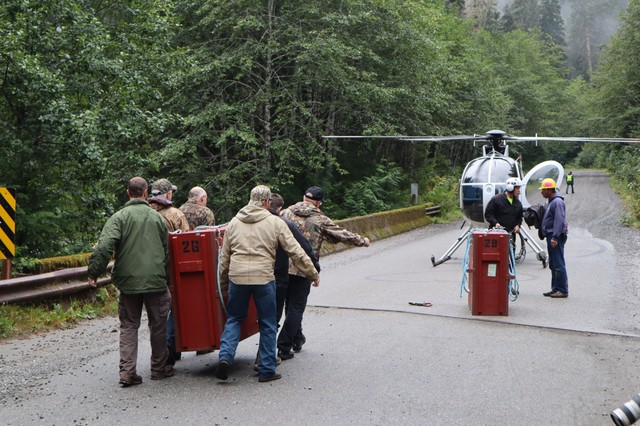 Wildlife biologists and volunteers relocated crated mountain goats by helicopter from a staging area on the Mountain Loop Highway east of Granite Falls, Washington.