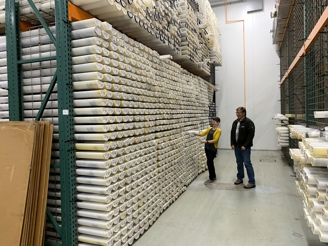 Curator Val Stanley and geologist Chris Goldfinger examine a sediment core in the vast collection of the Marine and Geology Repository at Oregon State University.
