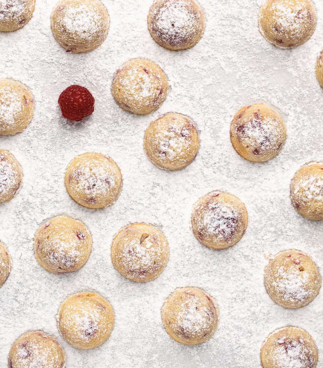 """These Raspberry Almond Tea Cakes are """"easy"""" (earning only one-half macaron out of three) and can be filled with frozen berries out of season. As with all """"Modern French Pastry"""" recipes, this requires a simple digital scale; you'll crack up when you learn the trick to measuring eggs in grams."""
