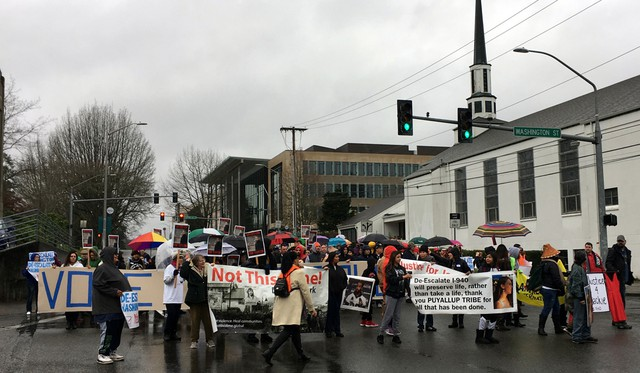 Relatives and friends of people killed in confrontations with police marched through Olympia Thursday in support of Initiative 940, a police accountability and training measure headed for the 2018 ballot.
