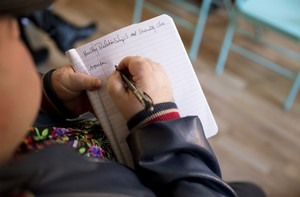 A student takes notes in Park's Relate class.