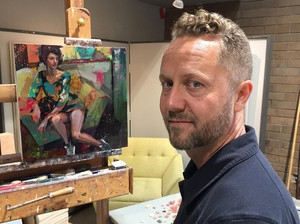 Ashland-based artist Gabriel Lipper stands next to his art piece. Lipper's influences range from French and Italian Renaissance painting to contemporary graphic novels and modern hip hop.