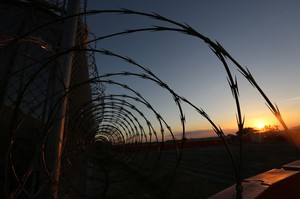 The sun sets on the U.S. detention center at Guantánamo Bay, Cuba, on Feb. 10, 2017.