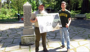 Tim Lussier of West Linn, Oregon, at right, is one of hundreds of descendants of the territorial government founders living in the Pacific Northwest today. His ancestor, Etienne Lucier, cast a deciding vote here in 1843. Park ranger Dan Klug holds a new interpretive panel.