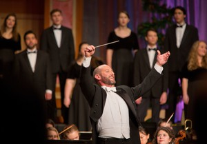 Brian Galante turns to the audience to conduct during the singing of a carol at A PLU Christmas featuring Angela Meade with the Choir of the West, the University Chorale and the University Orchestra at PLU on Friday, Dec. 11, 2015.