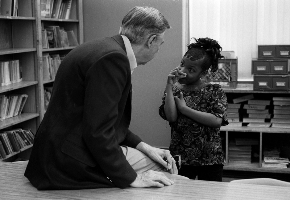 """During a Family Communications project about Heroes, Fred traveled the U.S. in search of adults whom he considered to be the """"helpers,"""" and on the way, he found children who touched his heart and told him the secrets of their lives. In Chicago, this child is telling Fred about the time she was shot."""