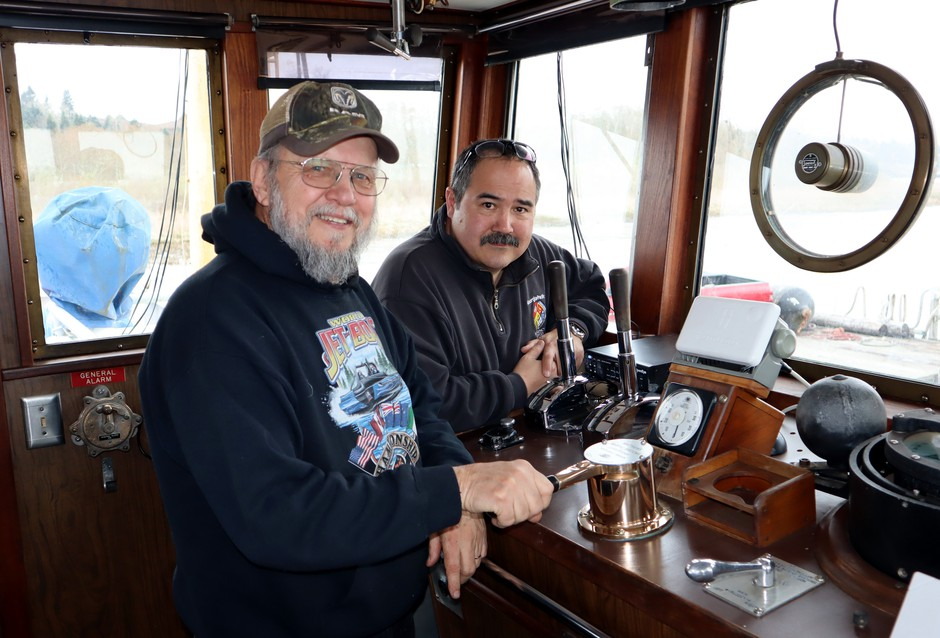 Salvage Chief Foundation chairman Don Floyd (front left) and the ship's owner Floyd Holcom on the bridge.