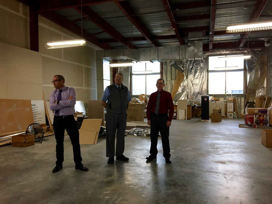 Brad Dixon, Bruce Siggins and Trevor Chowen (l to r) stand in unfinished space at the Washington State Patrol Vancouver crime lab that will be turned into a high-throughput lab to test rape kits.