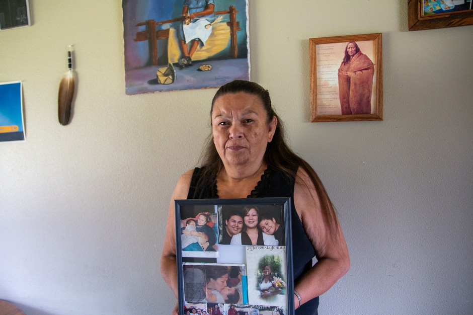 Vicky Jefferson holds a framed montage of photos of her daughter Shannon who died by suicide in the Whatcom County Jail.