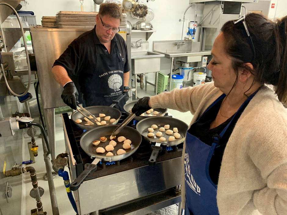 Tacoma-based seafood company owners Jim and Mona Stone prepare scallops to serve to taste testers at the OSU Food Innovation Center in Portland.
