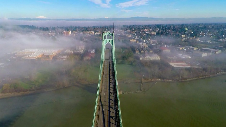 The St. Johns bridge was designed by David Steinman and completed in 1931. Today, the bridge is painted ODOT Green, but itwas initially supposed to be black with yellow stripes.