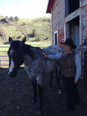 Liza Jane and her horse, Fly. She and her daughter, Adele, use horses to move their cows to different areas of the ranch to prevent overgrazing.