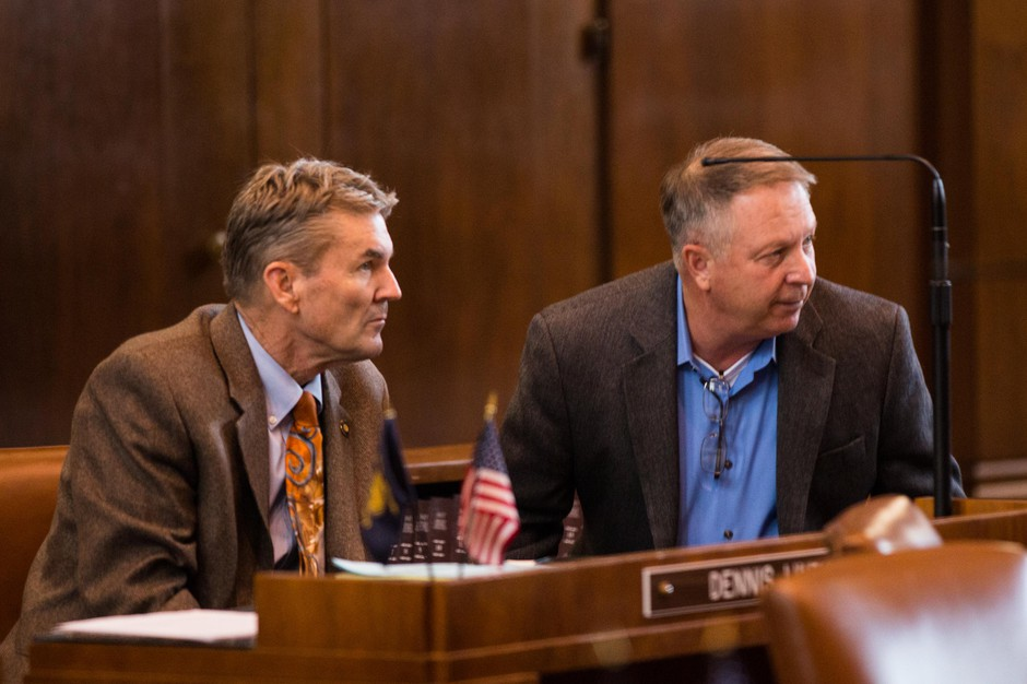 State Sens. Dennis Linthicum, R-Klamath Falls, and Herman Baertschiger Jr., R-Grants Pass, talk on the Senate floor at the Capitol in Salem, Ore., Thursday, April 11, 2019.