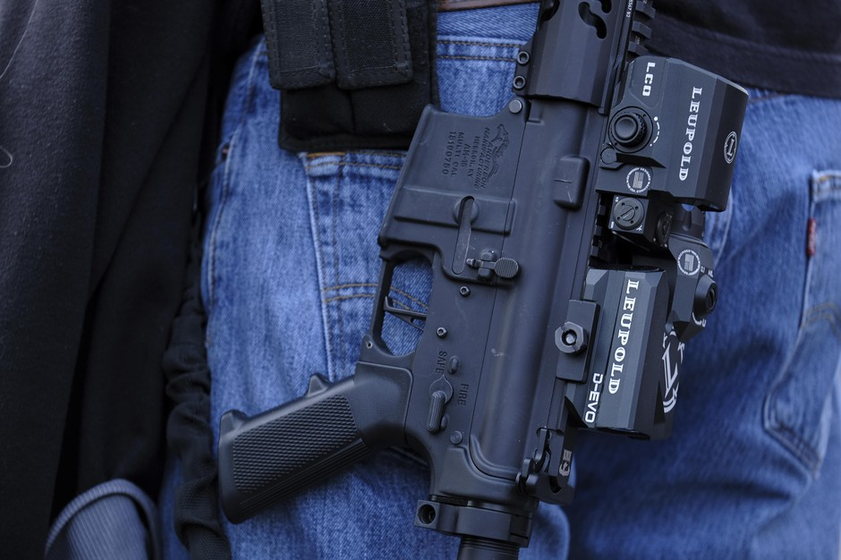 A veteran holds his AR-15 assault rifle at a rally organized by Radian Weapons and Noveske Rifleworks in front of the state Capitol in Salem, Ore., on March 23, 2019, to defend the Second Amendment in solidarity with similar events happening nationwide.