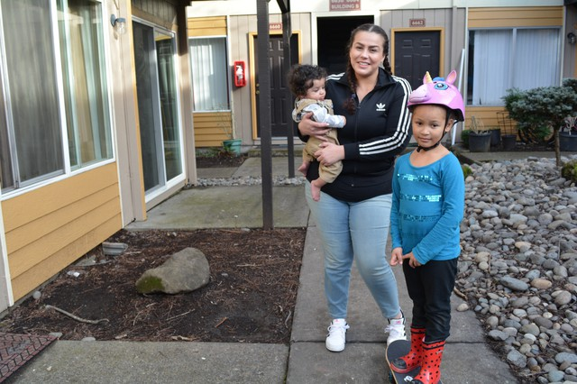 Coya Crespin with son, Titan, and daughter, Saraia, outside their apartment at Titan Manor. On Thursday, Jan. 5, 2018, she and other tenants filed a lawsuit against the complex's new owners.