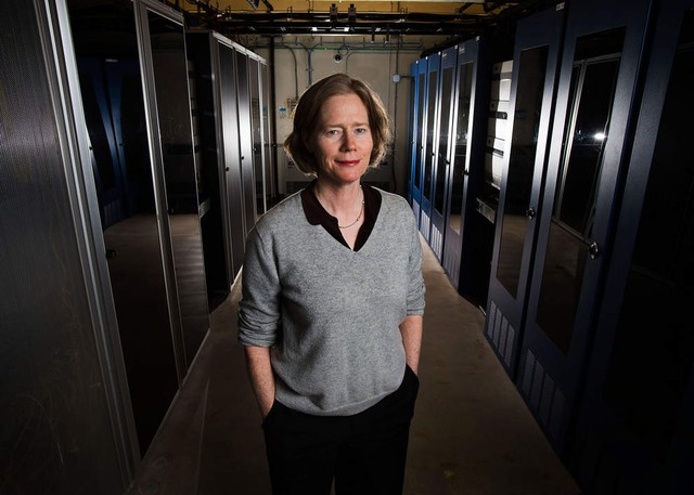 Anne Fifield, an economic development planner, stands in the Willamette Internet Exchange, or WIX, Eugene's fiber-optic hub. The city is set to expand its high-speed fiber project through much of downtown to create high-end public Wi-Fi and boost businesses in the area.