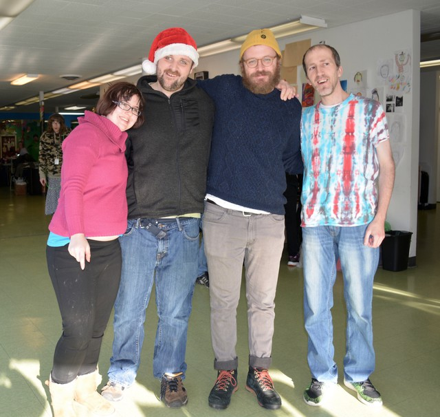 Alix, Bradley, Rob Gray, and Sean inside of Full Life, a day program for adults with developmental disabilities.