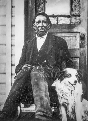 George Washington — pictured here with his dog, Rockwood — was a black pioneer who traveled west on the Oregon Trail and founded the town of Centralia, Washington.