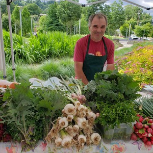 A vendor at the South Waterfront Farmers Market in Portland