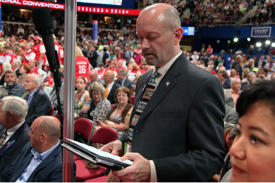 Bill Currier, chairman of the Oregon Republican Party, prepares to announce Oregon's votes during the roll call at the Republican National Convention in Cleveland on July 19, 2016.