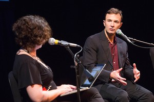"""Peter Ames Carlin speaks with OPB's """"State Of Wonder"""" host April Baer at Wordstock at the Dolores Winningstad Theatre in Portland, Oregon, Saturday, Nov. 5, 2016."""