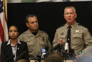 Douglas County Sheriff John Hanlin, right, addresses the media at a news conference at the Roseburg Public Safety Building in Roseburg, Oregon, on Oct. 2, 2015.