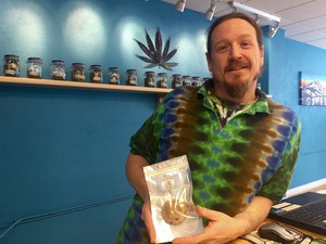 Stephen Layton displays one edible product currently sold by Dr. Jolly's dispensary in Bend. The new law now allows dispensaries to sell edibles to recreational as well as medical marijuana users.