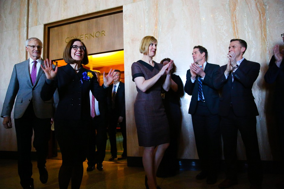 Oregon Gov. Kate Brown walks out of the Governor's Ceremonial Office following her swearing in on Jan. 14, 2019.