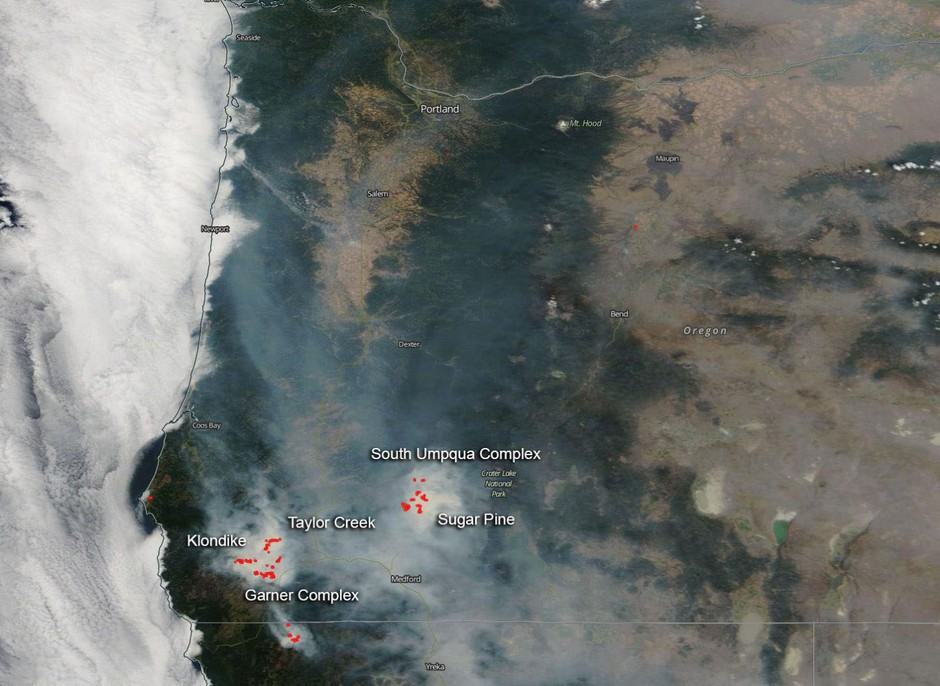 NASA's Aqua satellite captured the image of southwestern Oregon wildfires and smoke blowing from them on Aug. 6, 2018, with the Moderate Resolution Imaging Spectroradiometer, MODIS, instrument.