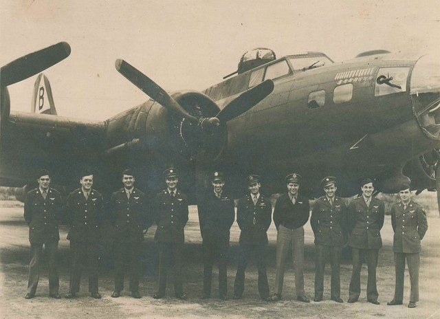 "Joe Ahearn, Sr. stands third from left in front of ""Ready Teddy,"" a B-17 that was built in Seattle. Of the 210 men in the 92nd Bombardment group, only 15 survived."