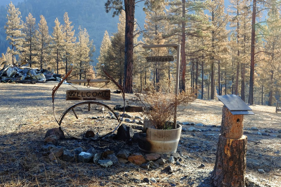 The wildfire spared the welcome sign, but not the Hodge's home behind.