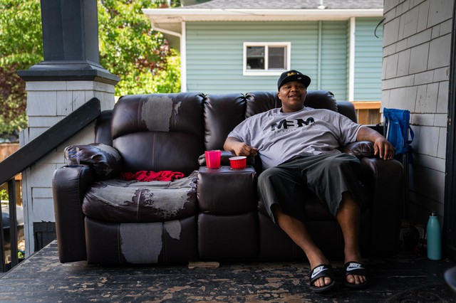 Lionel Irving sits on his porch on July 1, 2019, in North Portland, Oregon. Irving is trying to interrupt the cycle of violence in his community that led him to join a gang at a young age.