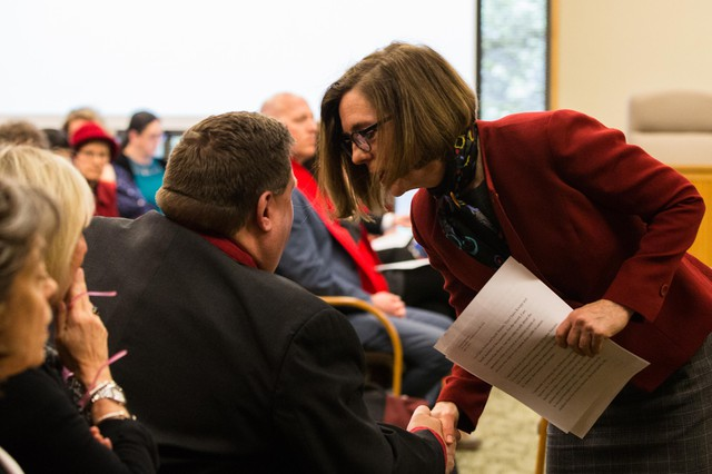 Oregon Gov. Kate Brown shakes hands with Oregon Education Association President John Larson after testimony on House Bill 2019 before the Joint Committee on Student Success at the Oregon Capitol in Salem, Ore., Thursday, April 11, 2019.