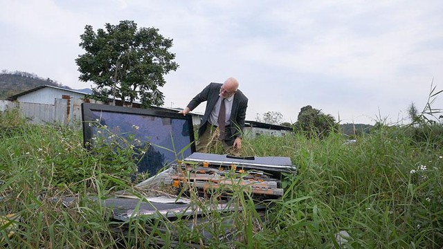A tracking device planted in a computer dropped off at a Dell Reconnect location led Basel Action Network's Jim Puckett here, an abandoned field strewn with LCD monitors, CRT monitors, camcorders and keyboards.