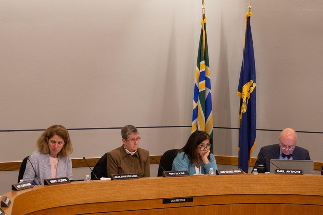 Portland Public School board members listen to public comments during a meeting on May 28, 2019.