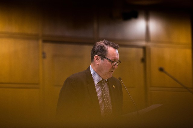 State Rep. Paul Holvey, D-Eugene, introduces legislation on the House floor at the Capitol in Salem, Ore., Tuesday, April 2, 2019.
