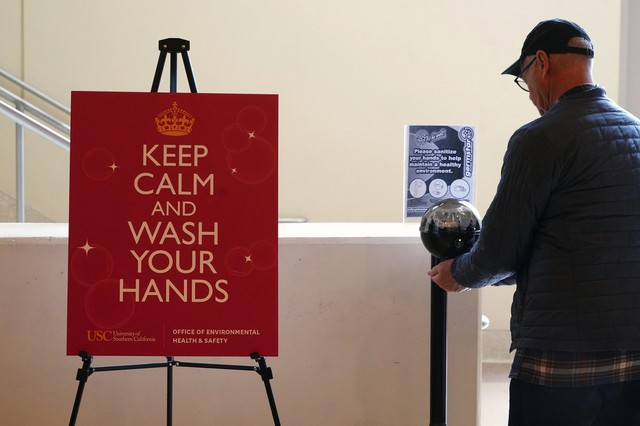 "Detailed view of hand sanitizer station with sign ""Keep calm and wash your hands"" provided by the University of Southern Califonria environmental health and safety department during an NCAA college basketball game at the Galen Center, Saturday, March 7, 2020, in Los Angeles."