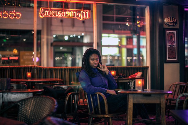 Amenta Abioto sits at Al's Den after a performance.