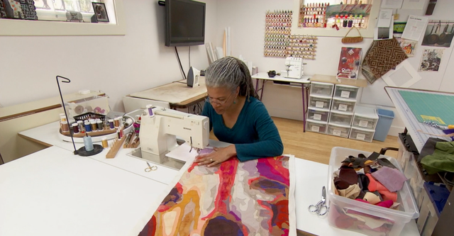 Sidnee Snell creates colorful, intricate quilts with her sewing machine.