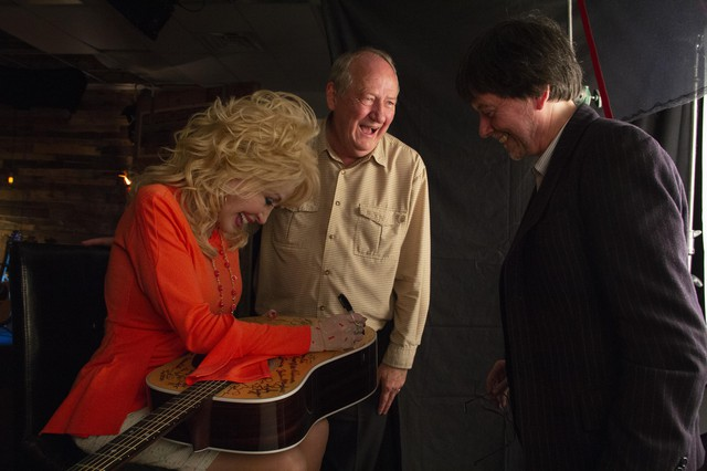 Dolly Parton (left) with documentary writer Dayton Duncan (center) and produce Ken Burns (right).