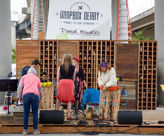 People set the stage for the Dropbox Derby auction. Dozens of handmade pieces of furniture are auctioned off to support Oregon's Tradeswomen Inc.