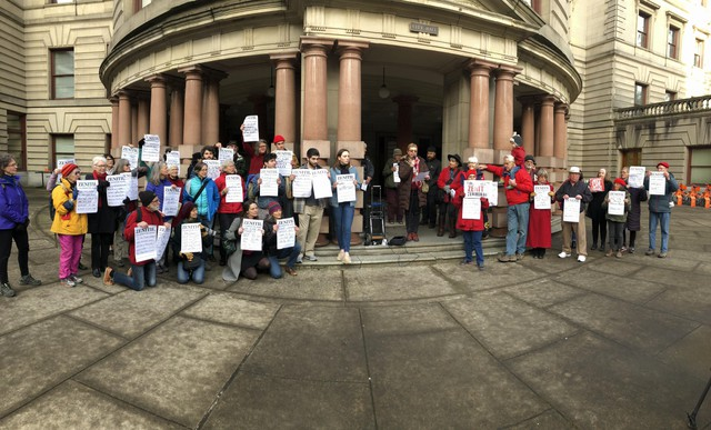 Protesters including the Raging Grannies, as well Oregon Physicians for Social Responsibility, Friends of the Columbia Gorge and high school students from the Portland Youth Climate Council, gathered in front of City Hall on Wednesday, March 13, to oppose the expansion of Zenith Terminals, which could increase the number of oil trains moving through Portland.