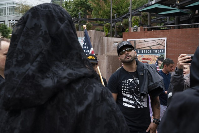 Patriot Prayer leader Joey Gibson argues withmembersof the Satanic Portland Antifascists during a Patriot Prayer march on September 15, 2019 in Portland's Pioneer Square.