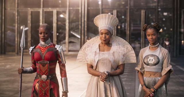 "Florence Kasumba (left), Angela Bassett (center) and Letitia Wright (right) in ""Black Panther,"" featuring costumes designed by Ruth E. Carter."