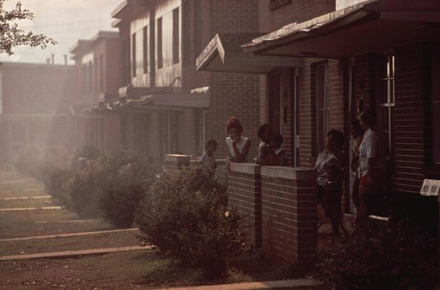 A photo taken in 1972 in Birmingham, Alabama, for the Environmental Protection Agency's Documerica program. The image captures the dense industrial smog in a neighborhood adjacent to a manufacturing plant.