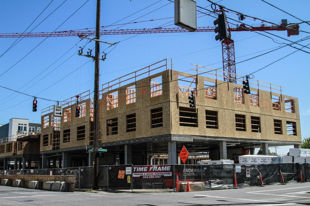 An apartment complex goes up in Portland. The city voted to tax new residential and commercial construction to help fund affordable housing projects.