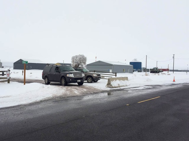 Federal Bureau of Investigation vehicles obstruct to entrance to the Burns airport Monday, Jan. 11, 2016.