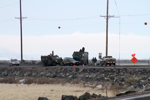 FBI officials have established checkpoints around the Malheur National Wildlife Refuge as a handful of armed militants remain inside.