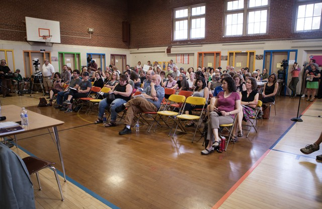 "Portland Public Schools Superintendent Carole Smith responds to a parent asking her to resign during a meeting at Rose City Park school in Portland, Oregon.  ""Does that fire alarm work? Is there asbestos in those vents? Do you want to tell us what works and doesn't work in our school?"" demanded Rob Neild, who has one child at Rose City Park."