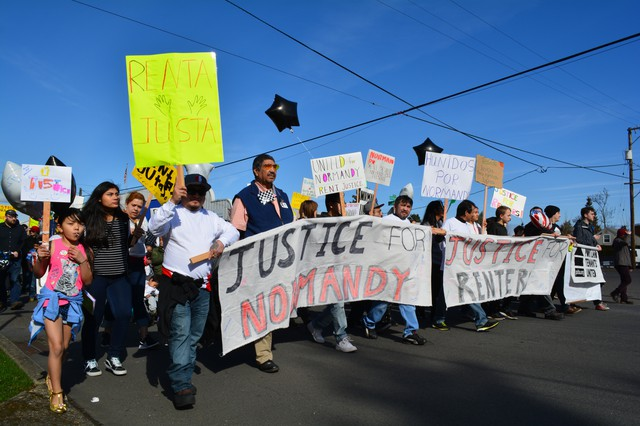 Tenants and housing advocacy supporters marched to protest a proposed 100% rent increase at the Normandy Apartments in northeast Portland.